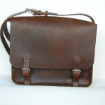 Brown sewn courier with buckles